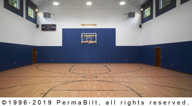 interior of pole building turned into basketball court