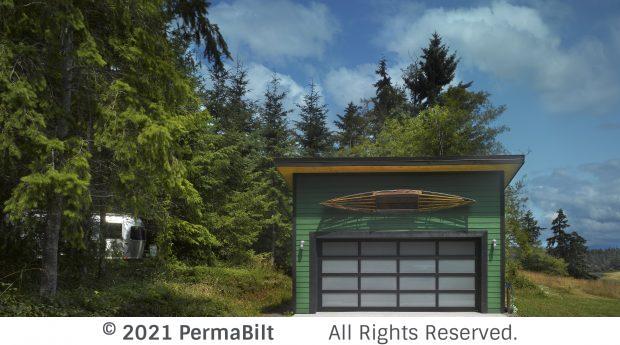 Garage with green siding and modern garage door