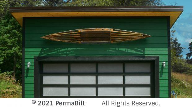 Garage with old kayak mounted above modern garage door