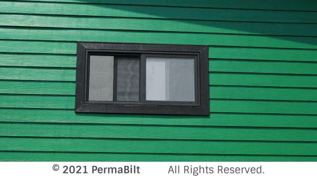 Garage close up with green siding and black trim