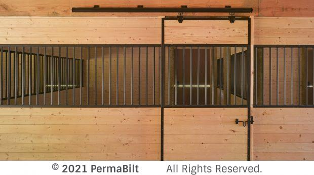Front of horse stall with black grill work and hardware