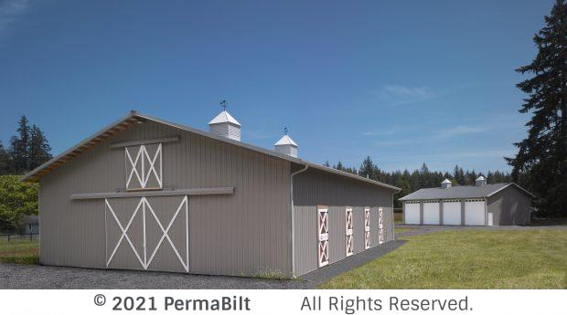 Pole barn with sliding doors, 4 dutch doors and cupola vents on roof.