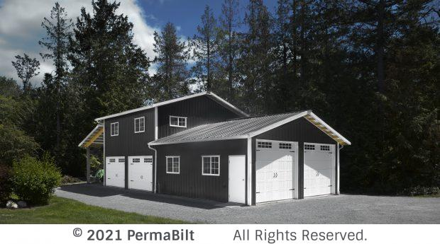 Garage building with 2 different eave heights. Each section has 2 carriage style garage doors