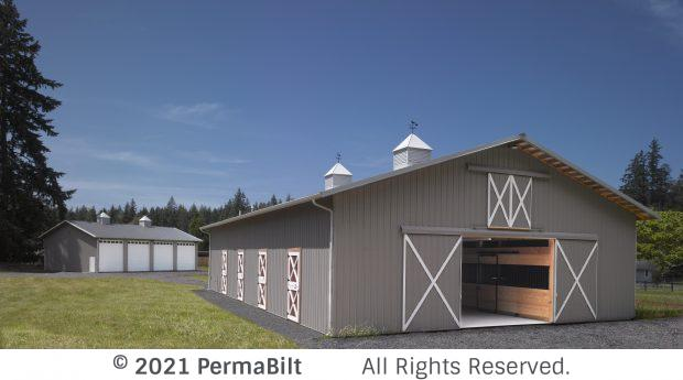 Pole barn with open sliding doors on the end and 4 dutch doors and cupola vents on roof.